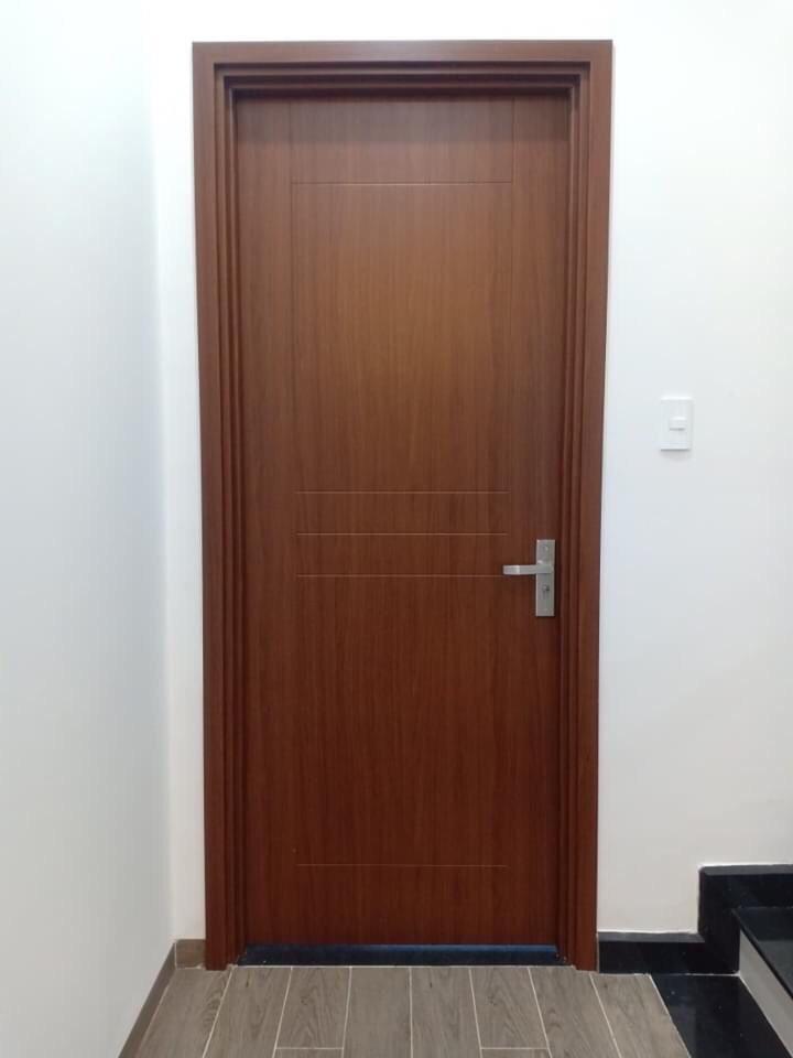 Mẫu cửa nhựa giả gỗ cao cấp cho phòng khách